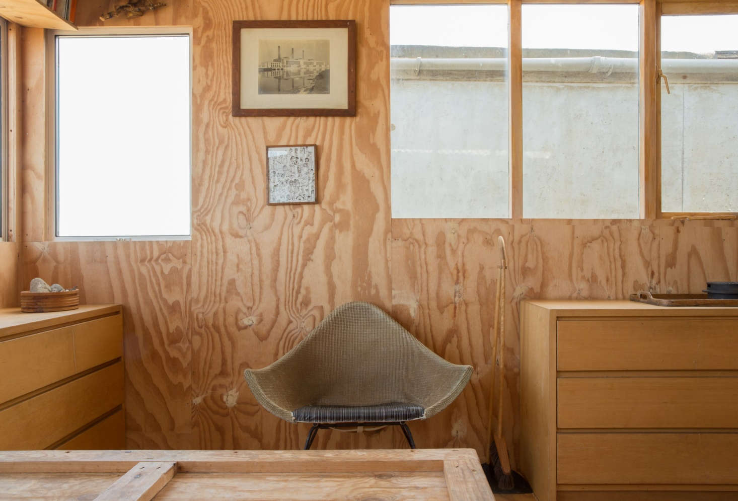 The grain is part of the charm in this plywood-clad beach house; seeTwo London Creatives Shore Up a Tiny Beach House for more.