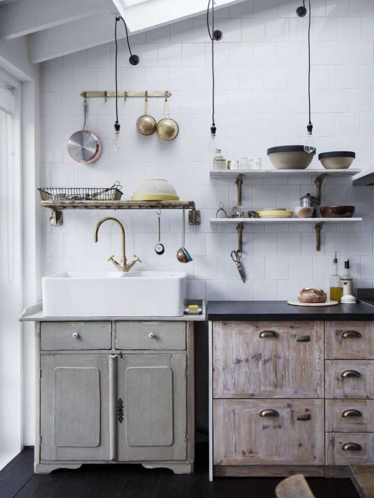 A wall-mounted dish drainer in a kitchen my Mark Lewis; see more at Custom Cast-Bronze Hardware from Mark Lewis in London in.