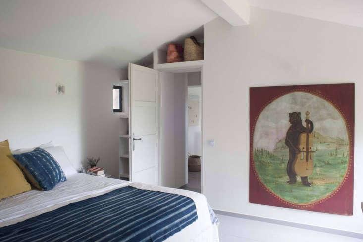 bedroom with fiddling bear painting at mas maroc, amanda pays corbin bernsen fa 19