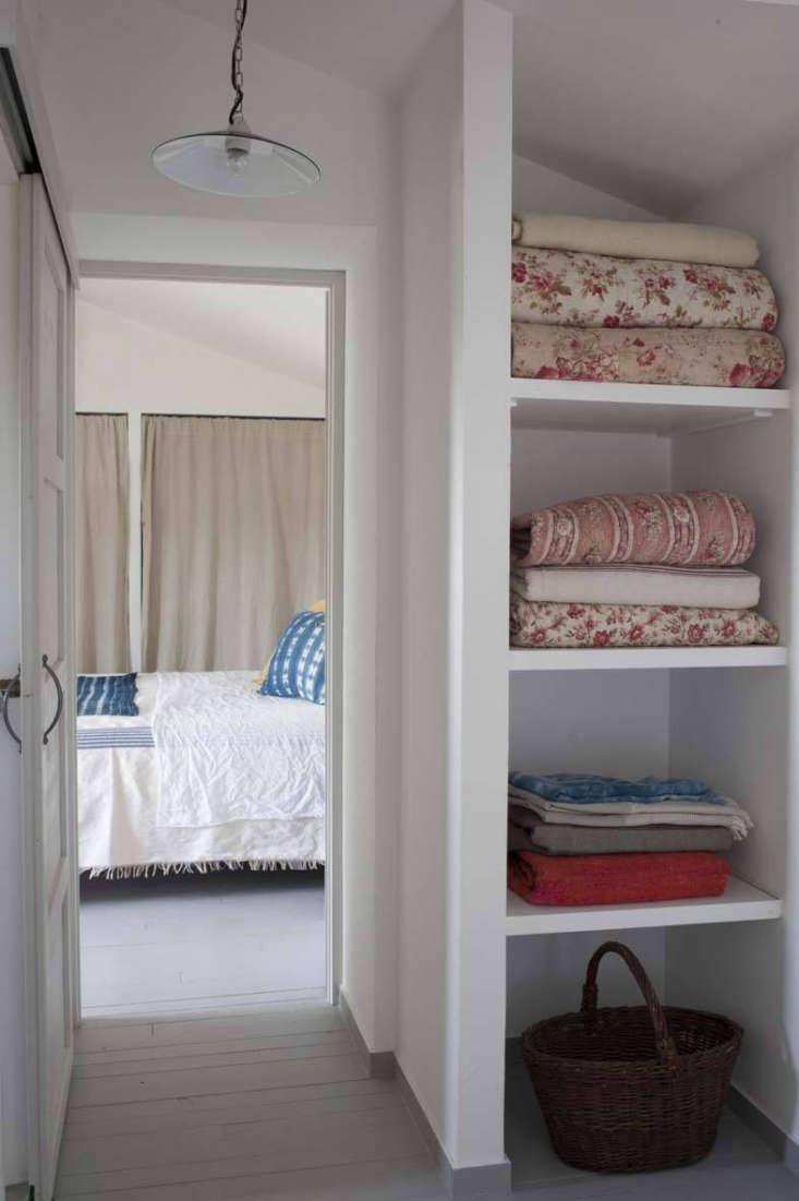 linen closet with floral quilts at mas maroc, amanda pays corbin bernsen farmho 21