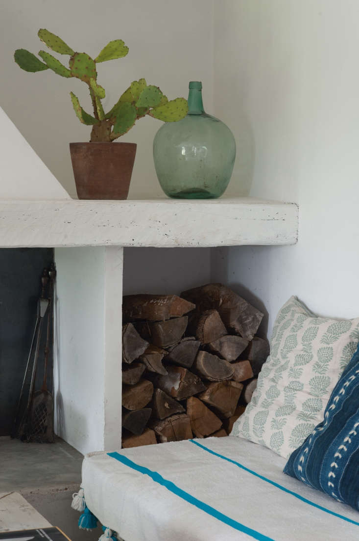 firewood storage is cleverly incorporated into the mantel thanks to a newly add 16