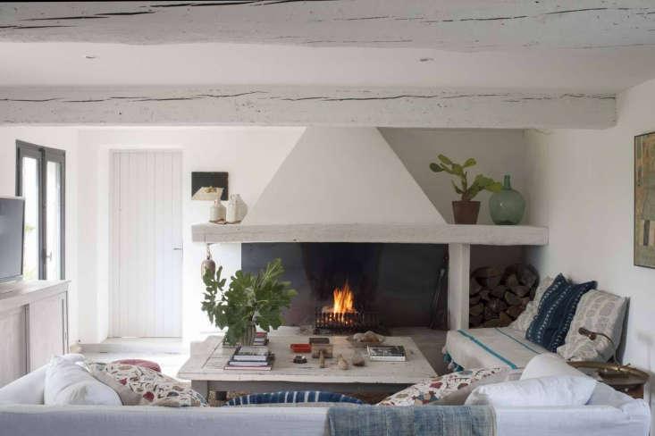 living room stucco fireplace at mas maroc, amanda pays corbin bernsen farmhouse 15