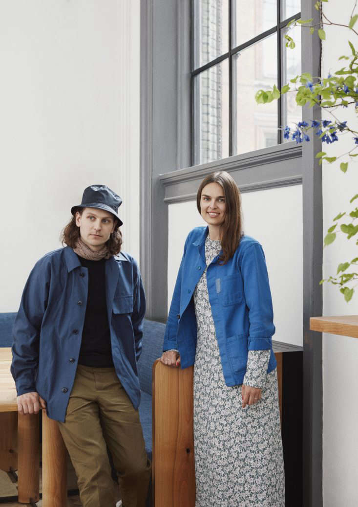 frederik bille brahe and mette hay both wearing utilitarian french work jackets. 25