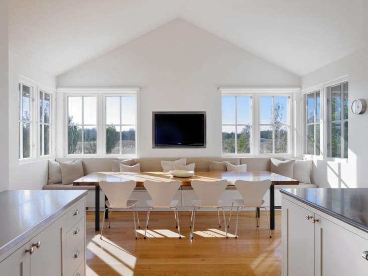 Simple roller shades in a white setting become part of the architecture. When rolled up, the shades form a barely noticeable horizontal line. Photograph by Bruce Damonte, featured in The Architect Is In: A Ranch Turned Farmhouse in Sonoma County.