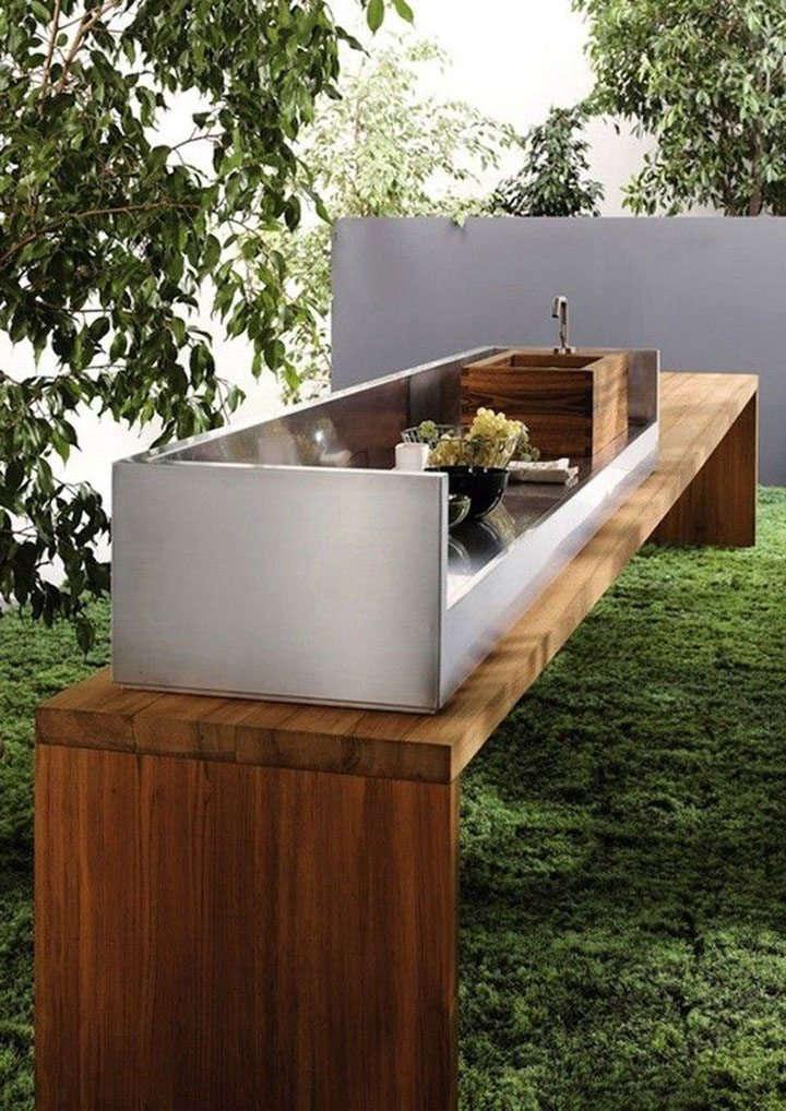 A sleek teak and steel outdoor kitchen from Italian company Mebart.