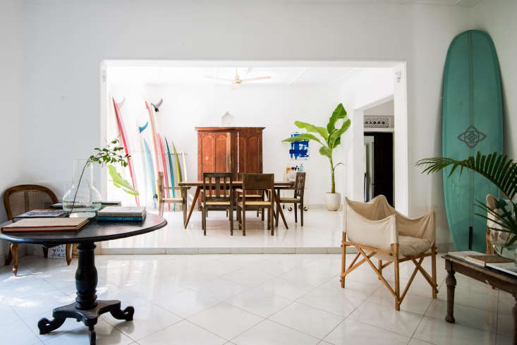The white-tiled floor and much of the wooden furniture, including the living room&#8