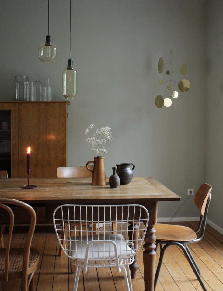mismatched chairs, from bentwood to eames to a school relic, surround the table 19
