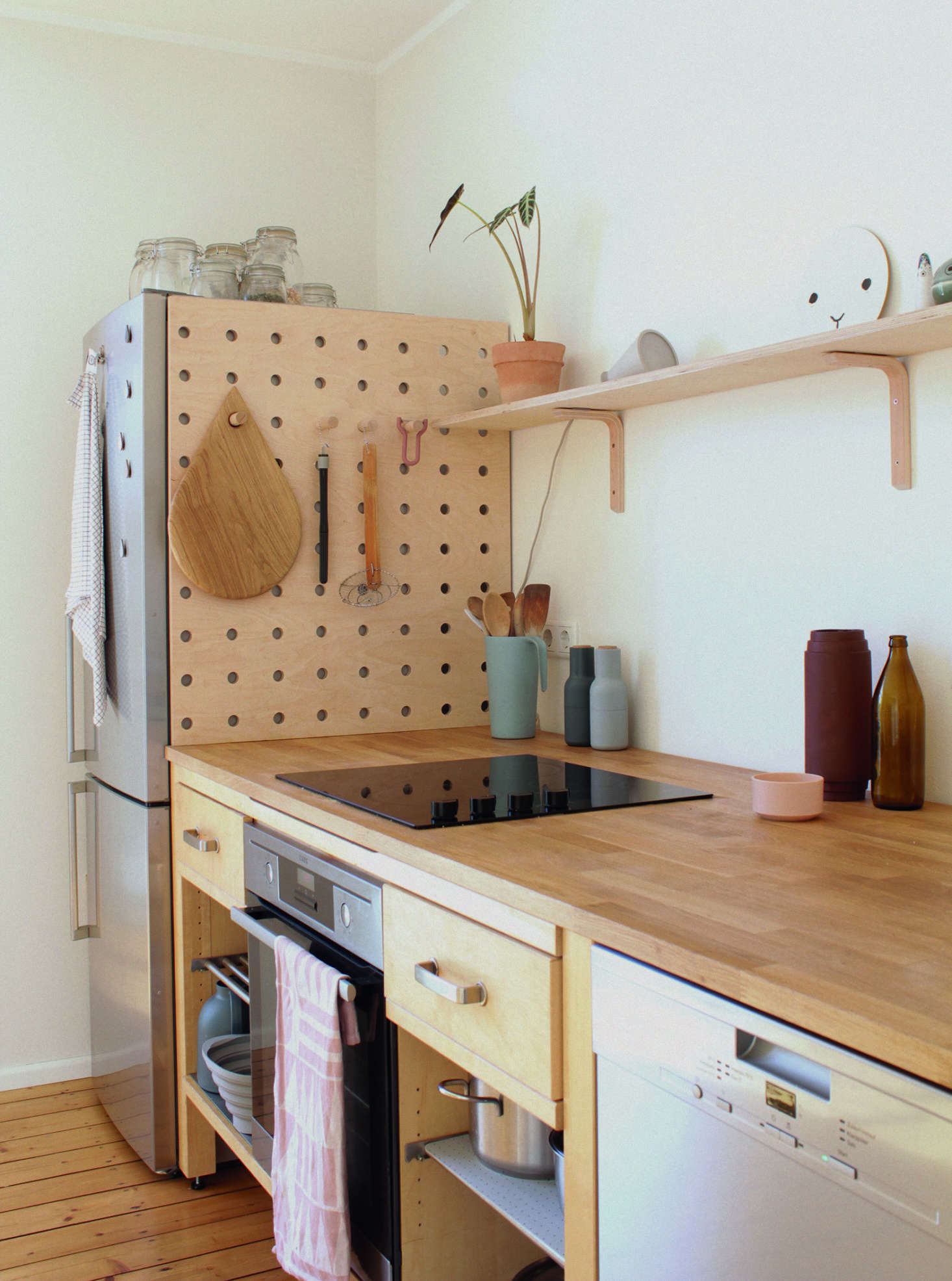 In the German kitchen of illustrator and graphic designer Swantje Hindrichsen,a pegboard hides the gap behind the fridge, which wasn't deep enough to meet the wall. See more inKitchen of the Week: An Artful Kitchen Created from Reclaimed Ikea Parts, Extreme Budget Edition.
