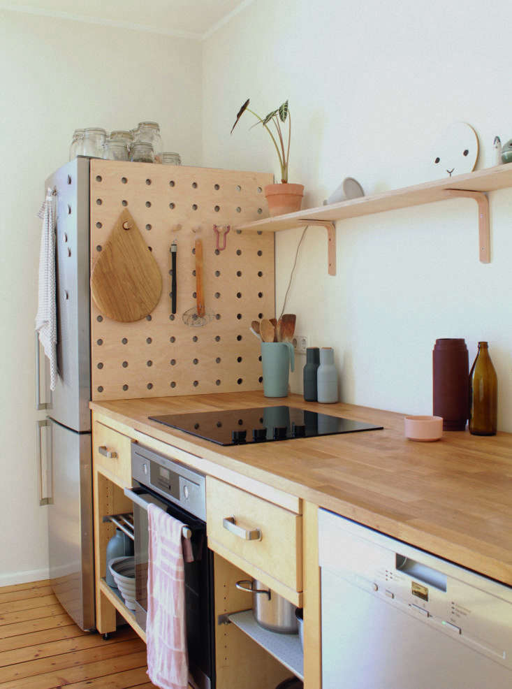 the pegboard is used for hanging handy stove side tools, such as tongs and a sk 12