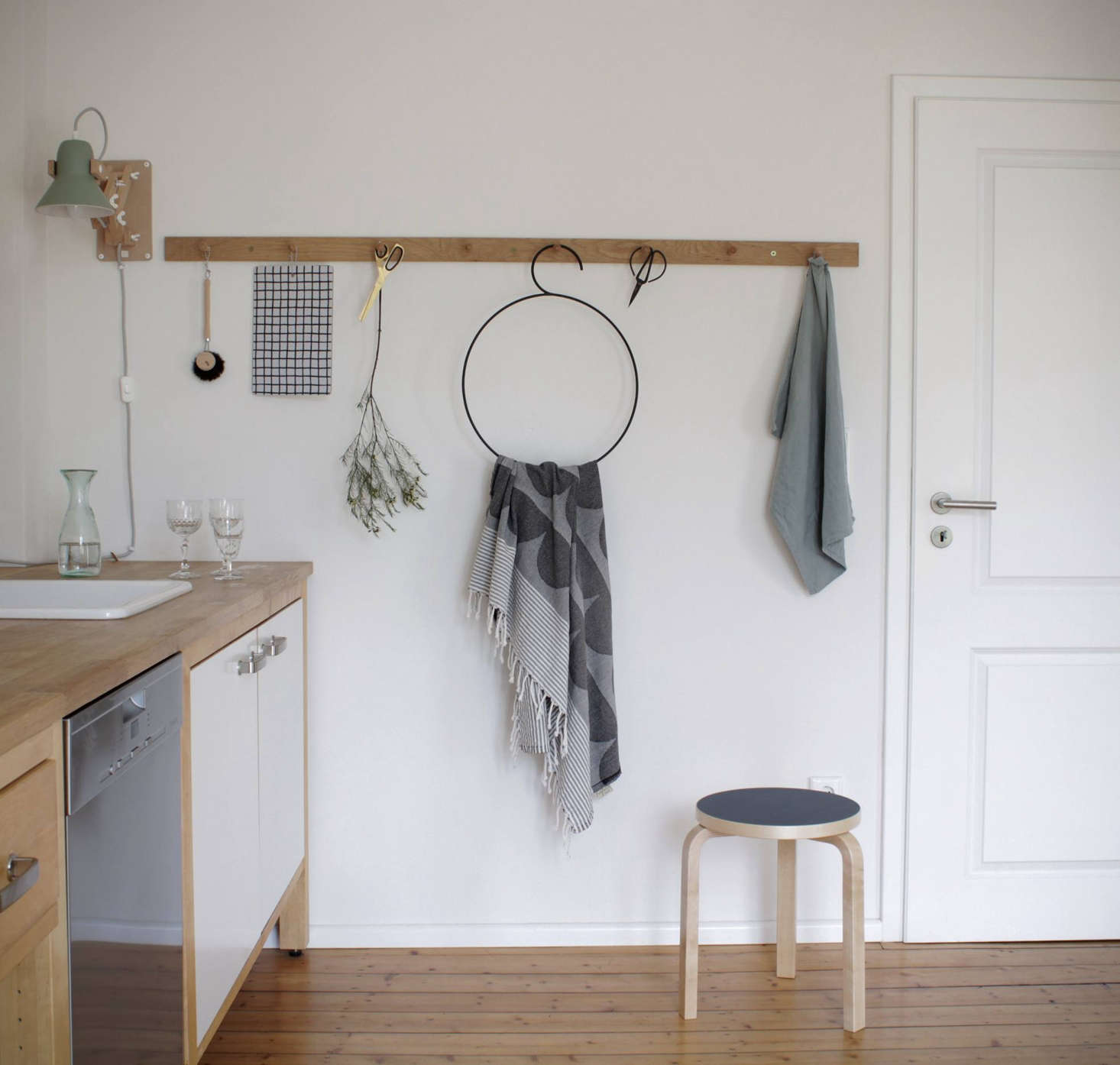 An illustrator and graphic designer installed a peg rail along an empty wall in her kitchen, an opportunity for both practical storage and artful display. See Kitchen of the Week: An Artful Kitchen Created from Reclaimed Ikea Parts, Extreme Budget Edition for more of the kitchen.