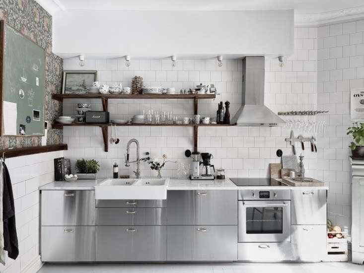 Johanna Bradford of Swedish design blog Lovely Life overhauled her Gothenburg kitchen with stainless steel drawers, marble countertops, and floral wallpaper. See the rest inKitchen of the Week: An Industrial Yet Romantic Swedish Kitchen.Photograph by Anders Bergstedt for Entrance.