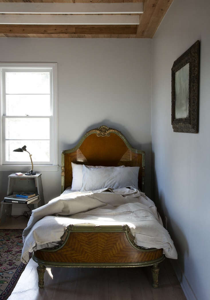 a vintage twin bed in one of the bungalows. 14