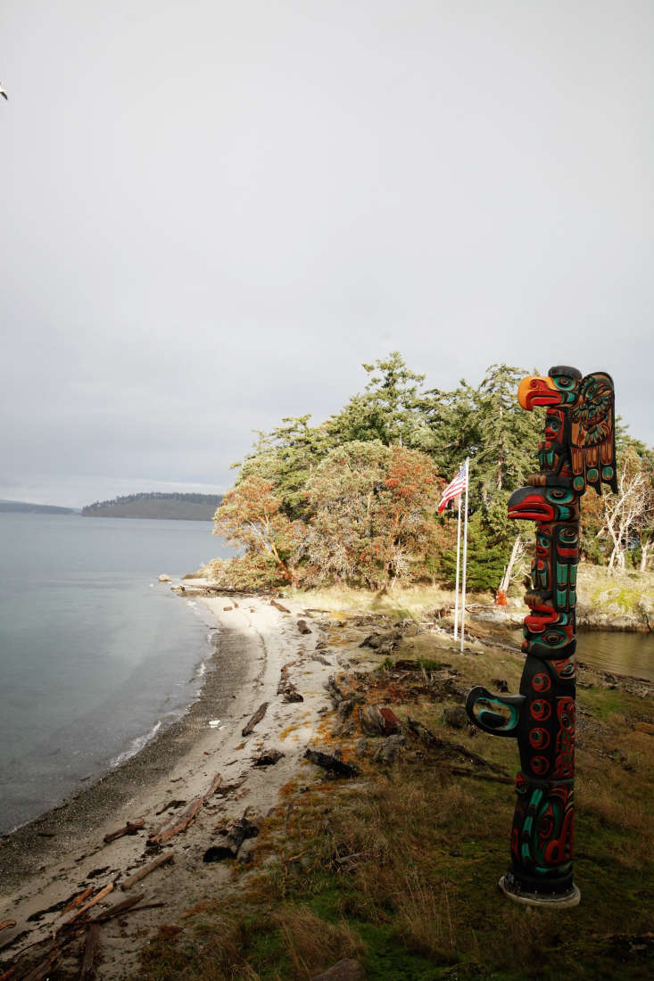 A totem pole carved by Kwakiutl artist Tom Hunt beckons from the shoreline.