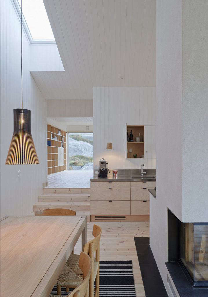 Located on the island of Vega in the Norwegianarchipelago, this kitchen in a private residence by Kolman Boye Architects features expansive views, shiplap paneling, and stainless steel countertops. See more inThe Outermost House: A Norwegian Island Retreat. Photograph by Åke E:son Lindman, courtesy of Kolman Boye Architects.