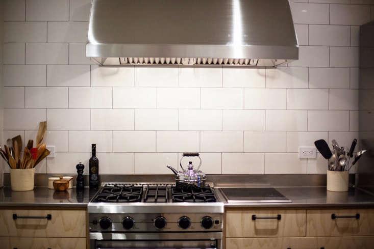 white tile backsplash stainless hood nyc kitchen range