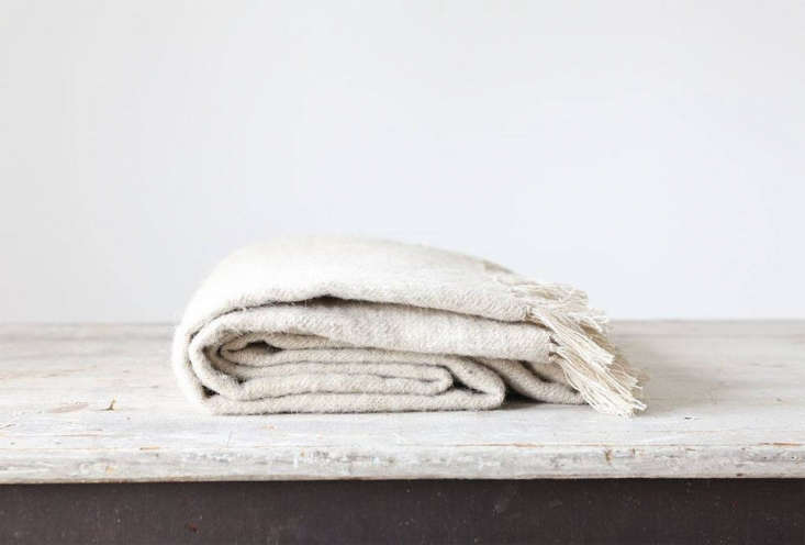 The Neem Living Natural Fringed Wool Throwis $375 at Alder & Co.