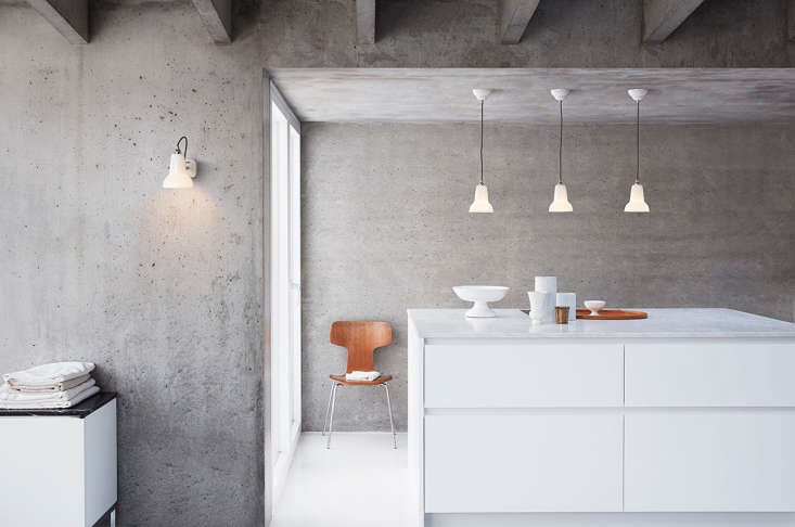 the ceramic wall light and trio of pendant lights in a kitchen. 13
