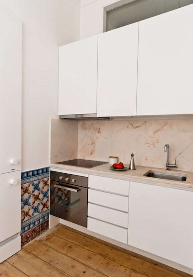 Baixa House, a hotel of guest rooms in Lisbon, Portugal, features small kitchenettes with pink marble countertops.