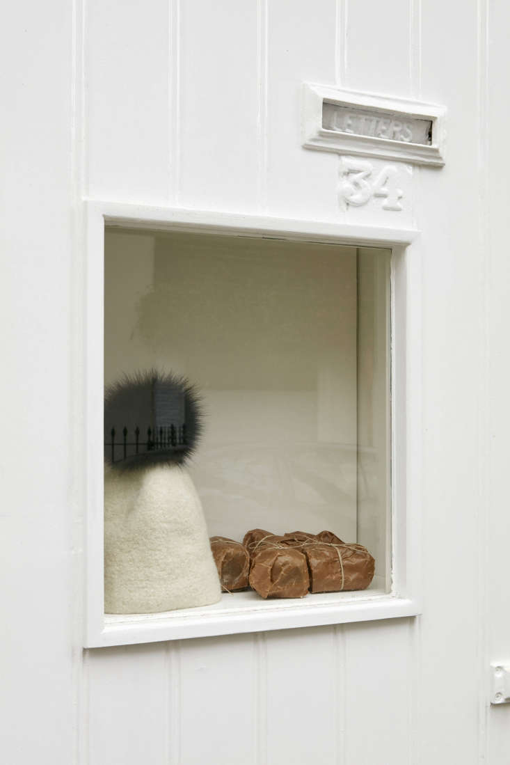 A window display featuring a hat by Otto, one of a small family of brands Egg carries,and soap from the oldest soap factory in England, wrapped in wax paper. Photograph by James Brittain.