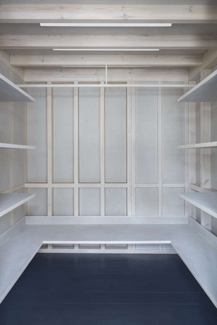 """""""I needed semi-big closets because I wear frocks to work,"""" says Maureen. The entire structure is built from exposed European redwood and chipboard walls that are finished with Osmo White Satin wood wax finish. The floors are painted in gloss Dulux Floorshield. Photograph by Dirk Lindner."""
