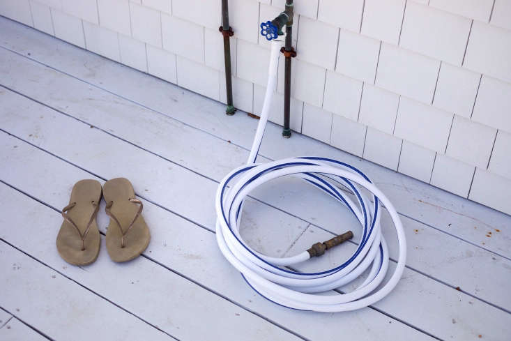 An outdoor shower and hose for after-beach cleanup.
