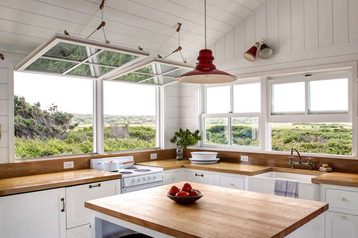 The reconfigured kitchen overlooks the Great Sippewissett Marsh, a protected tidal salt marsh.