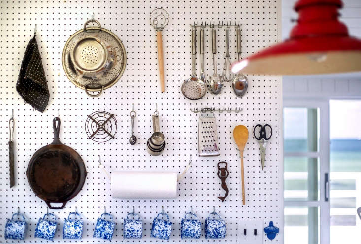 A Julia Child–style pegboard holds a kitchen&#8