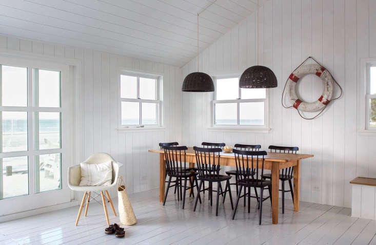 The Wicker Dome Pendant Lights are from Kouboo; Victoria spray-painted them and had them rewired with gray cloth electrical cord. The Case Study Arm Chair Dowel is from Modernica  (&#8