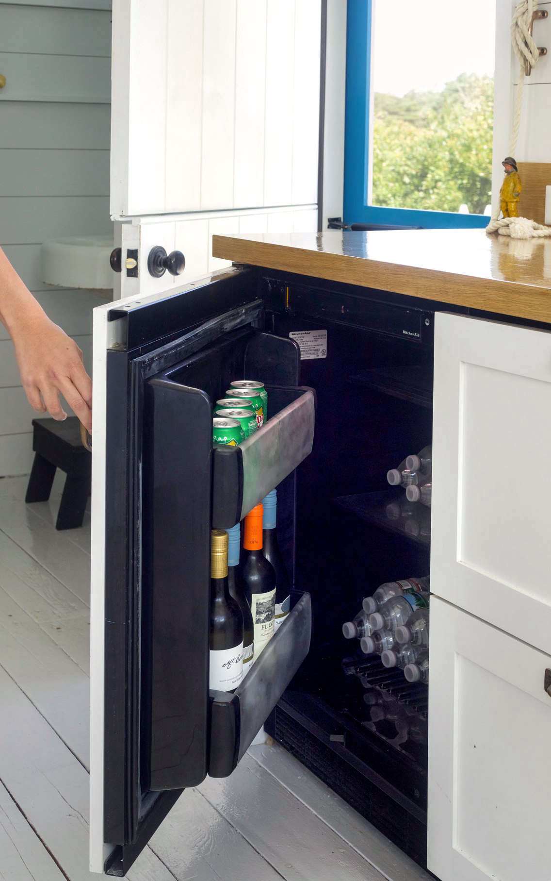 A Kitchenaid -Inch Panel Ready Undercounter Refrigerator serves as a mini drinks refrigerator.