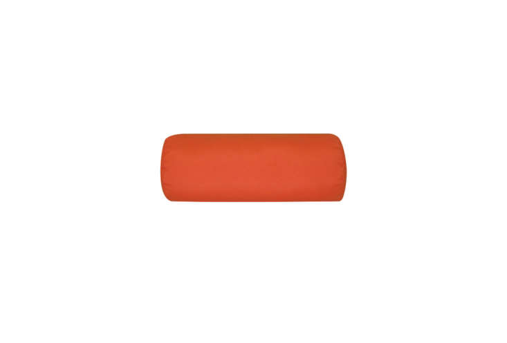 Steal This Look CampStyle Bedroom with Bold Color The Fiberbuilt Round Sunbrella Outdoor Bolster Pillow is similar to the custom made one in the Basecamp bedroom; \$57.99 to \$63.99 at DFO Home.