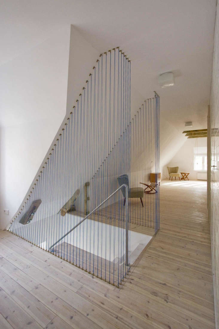 In an effort to keep the space open—and with a nod to maritime design—the staircase is bordered by 500 meters (loading=