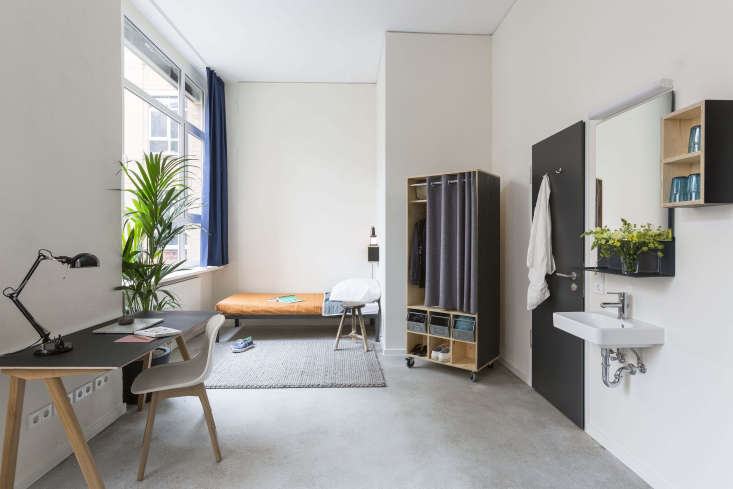 11 HostelStyle Lodges for the New International Nomad New York–based property developer Macro Sea used easy to rearrange wheeled wardrobes and other wooden cubes in itsG.\27 Global Institute Berlin, a combination campus and dormitory.