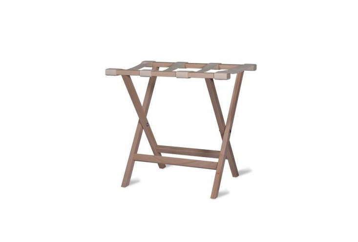 The Weekend Folding Luggage Rack in Beech with fabric straps; £48 ($64 USD) at Garden Trading.