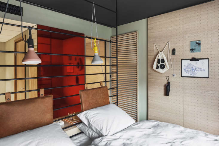 SmallSpace Solutions 5 Tiny Bedroom and Dorm Ideas to Steal from Stockholms Hobo Hotel Introducing mirrors is an age old way to create the illusion of extra square footage. Studio Aisslinger added a surprise touch: a rose colored mirror that contrasts with the pale green gray walls.