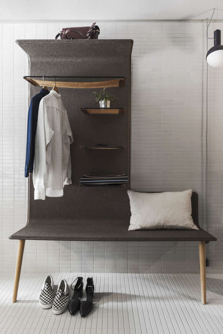 SmallSpace Solutions 5 Tiny Bedroom and Dorm Ideas to Steal from Stockholms Hobo Hotel A Studio Aisslinger felt fleece lined bench incorporates shelves and a hanging rack.