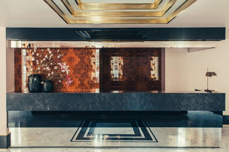 The concierge desk is kitted with mirrored glass and layers of rare marble. Everything at the Hotel Saint Marc is custom-made.