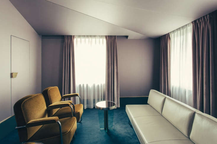A mauve-colored hotel suite resembles a luxe 50s Milanese waiting room.