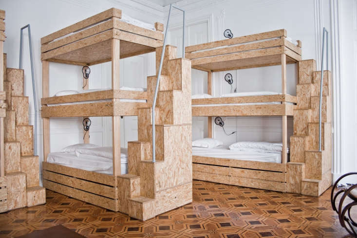 11 HostelStyle Lodges for the New International Nomad Custom particle board bunk beds designed by architect Catarina Cabral contrast with the parquet flooring and soaring ceilings at Lisbon&#8\2\17;s Independente Hostel & Suites set in what had been the Swiss ambassador&#8\2\17;s residence.There are \1\1 dorms—and room for 90—plus a second location with suites and terraces next door.