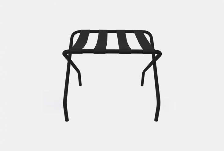 From Innit Designs, a tubular steel and PVC strap Pamaleta Luggage Stand in black (also available in white and other colors) is $