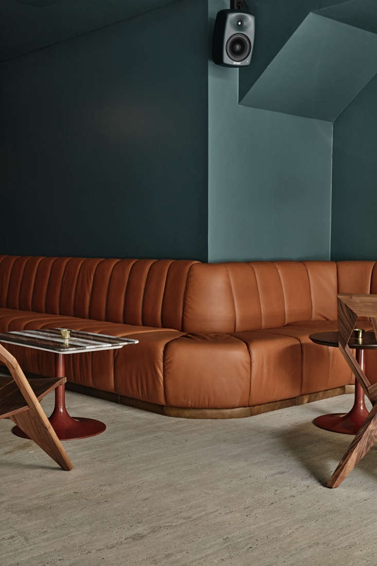 the leather benches and tables are custom. the chairs are walnut medici chairs  10