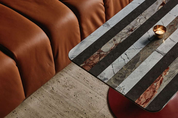 a detail of the custom tables laajisto commissioned in stripes of exotic marble. 15