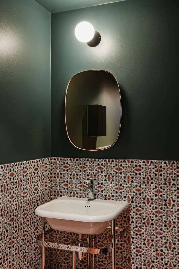 the bathroom features mainzu tile, a muuto framed mirror, and cone sphere wall  16