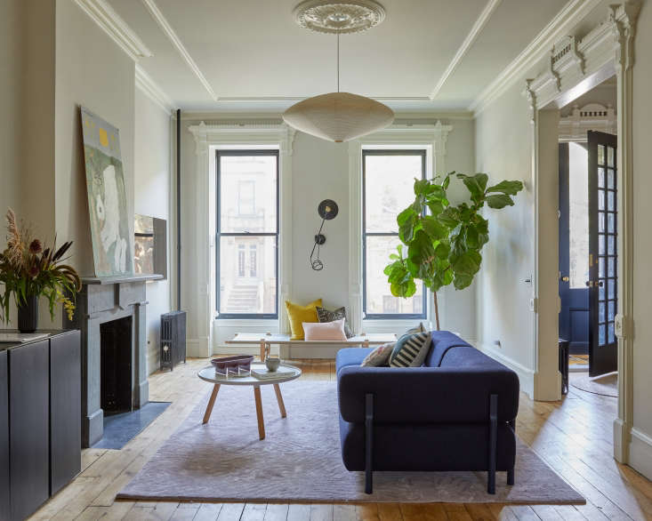Architect Jess Thomas chose a Noguchi ceiling light for her own living room. Photograph by and courtesy ofKate Sears; styling by Kate S. Jordan, from The Sentimental Minimalist: A Young Architect&#8