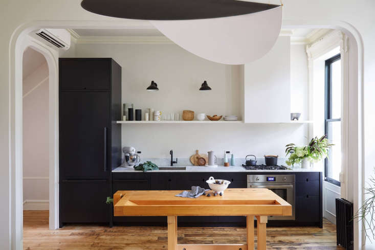 a wide archway connects the approximately 90 square foot kitchen and the twice  9