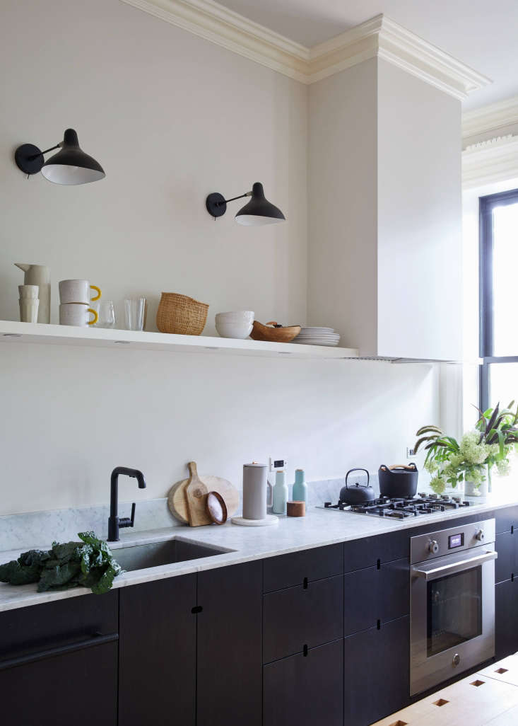 for a seamless look, the cabinets have capsule shaped cutout handles (see the e 11
