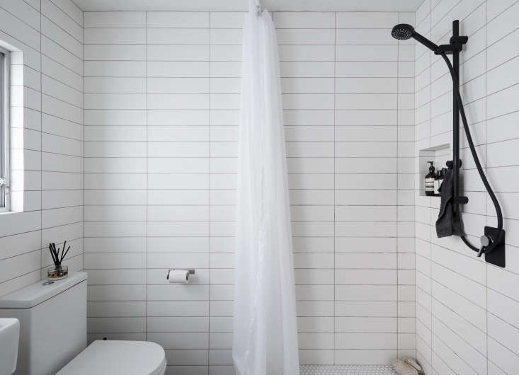 A shower curtain replaces the clunky glass enclosure from before. A black and white palette keeps the small space clean-lined but a little edgy: Spath sourced the white white subway tiles from Tile Space and the matte black fixtures from The Kitchen Hub, both in Auckland.