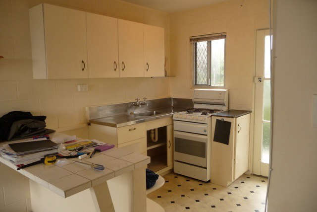 The former kitchen was clunky and large for the space. Photograph courtesy ofKarin Montgomery Spath.