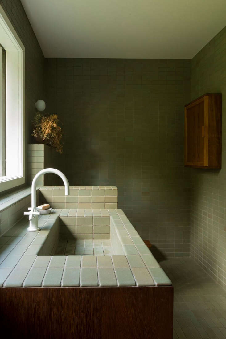 The shade of green in tile form at a bathroom by Katie Lockhart, done in Heath Ceramics tile color &#8