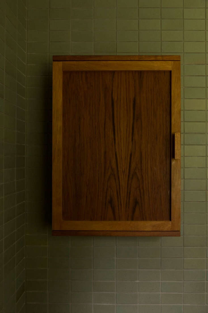 The custom medicine cabinet in Iroko wood was made with Grant Bailey.
