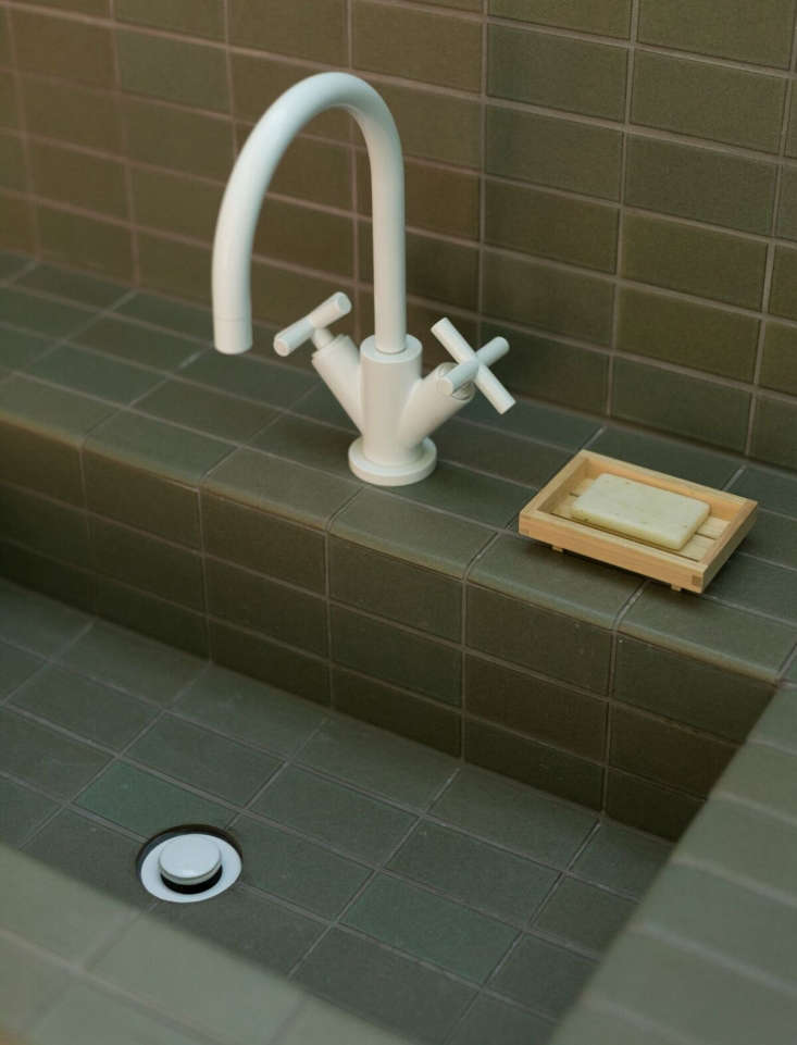The faucet is theDornbracht Tara Single Hole Lavatory Mixer with the Dornbracht Drain both in matte white. The soap dish is the Claska Hinoki Soap Dish from Everyday Needs.